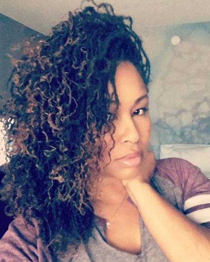 Professional stylist. Cute sisterlocks on pretty black woman. sisterlocs.