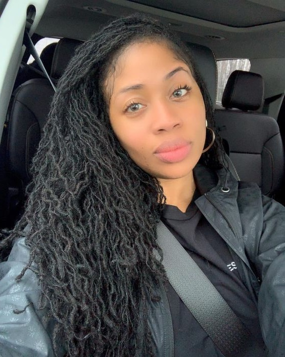 Cute sister locks style on pretty black young woman. sisterlocs.