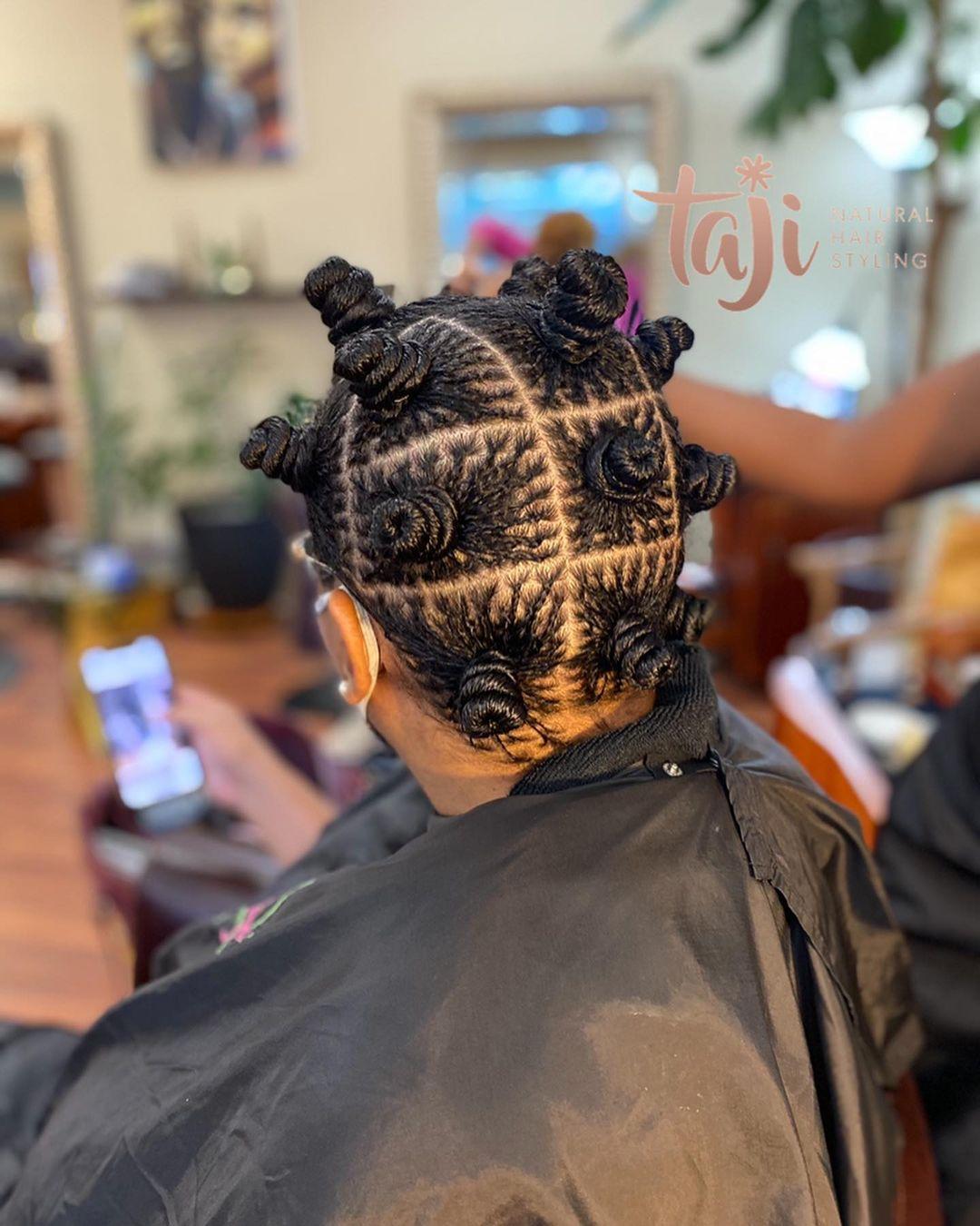 Black hairstyles mini micro braids spirals.