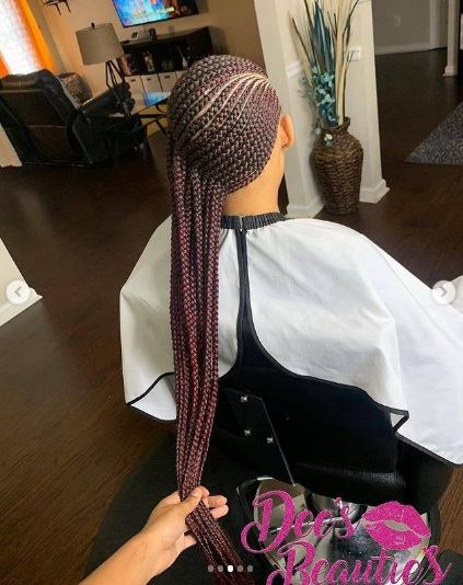 Cute Lemonade braids style on pretty black young woman. Lemonadebraids