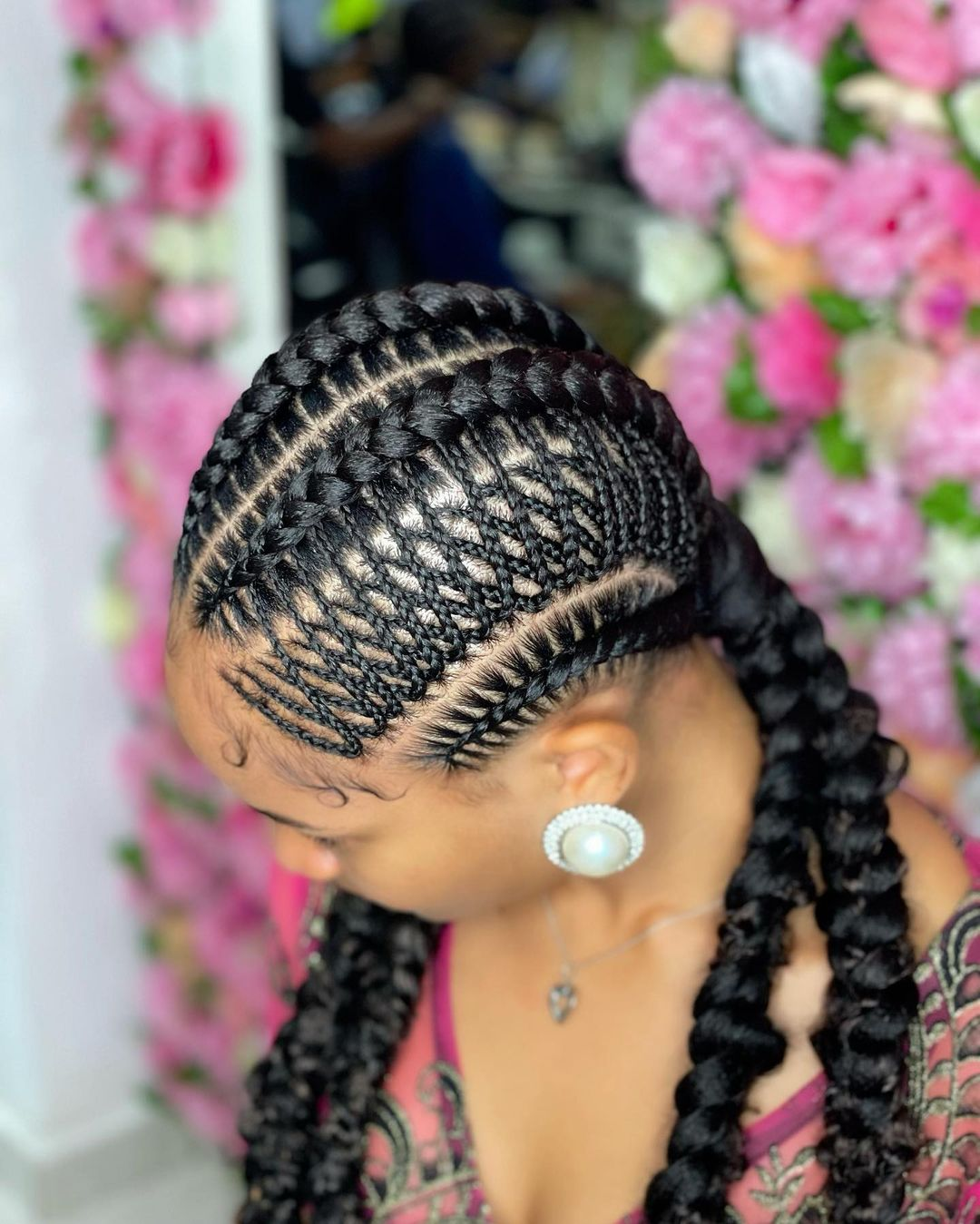 Brown-skinned African american girl. feed-In stitch braids, two feed in braids, small feed in braids ponytail, 6 feed in braids with box braids